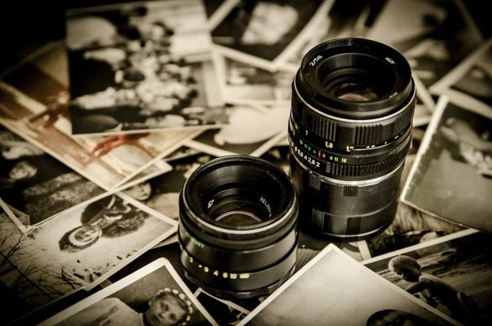 A camera lens surrounding photos.